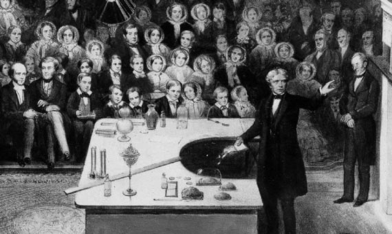 Michael Faraday delivering a Christmas Lecture at the Royal Institution in 1856 / Credits: Wikipedia