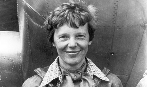 Amelia Earhart standing under nose of her Lockheed Model 10-E Electra in 1937. Credit: Wikimedia Commons