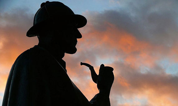Evening silhouette of Sherlock Holmes's statue at Baker street, the real place where he never lived. Credit: Wikimedia Commons