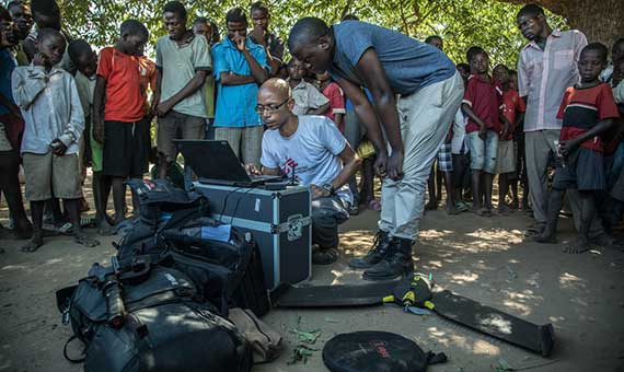 Rafael Brechard, MSF GIS Manager, prepare the flight of a drone in a community in Malawi. Credit: Morgana Wingard - MSF