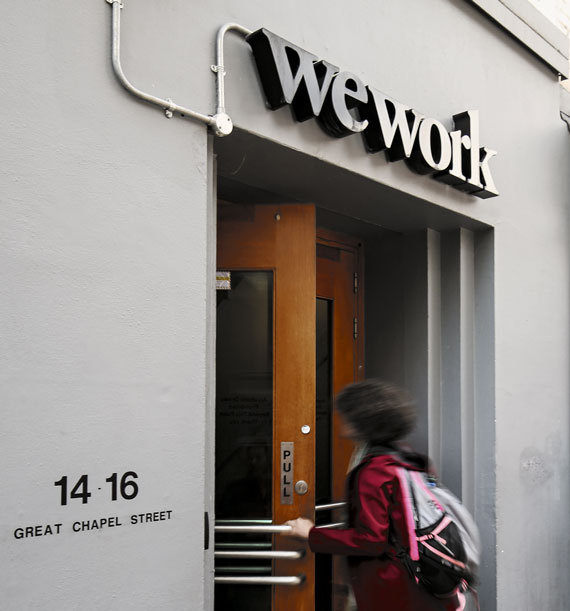 Signage outside the co-working office space group WeWork in London